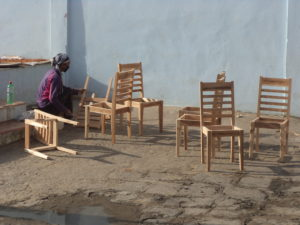 One female family member busy to making furniture