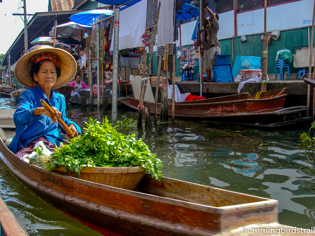 A lady in mo hom on her Sampan